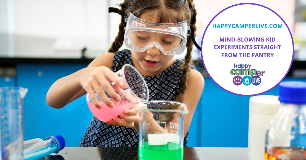 a little girl doing a science experiment in the kitchen pouring liquid into a measuring cup