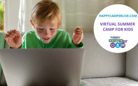 a kid having fun and smiling at the computer doing virtual summer camp for kids