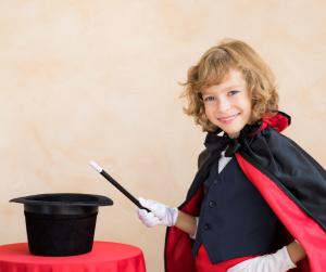 kid performing magic
