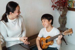 kid playing ukelele