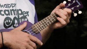 hands playing ukelele