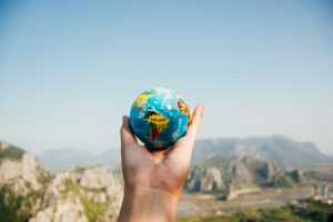 hand holding mini globe