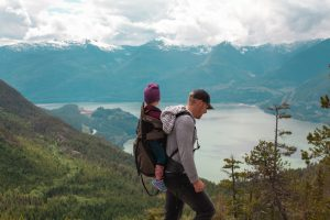 dad hiking with kid